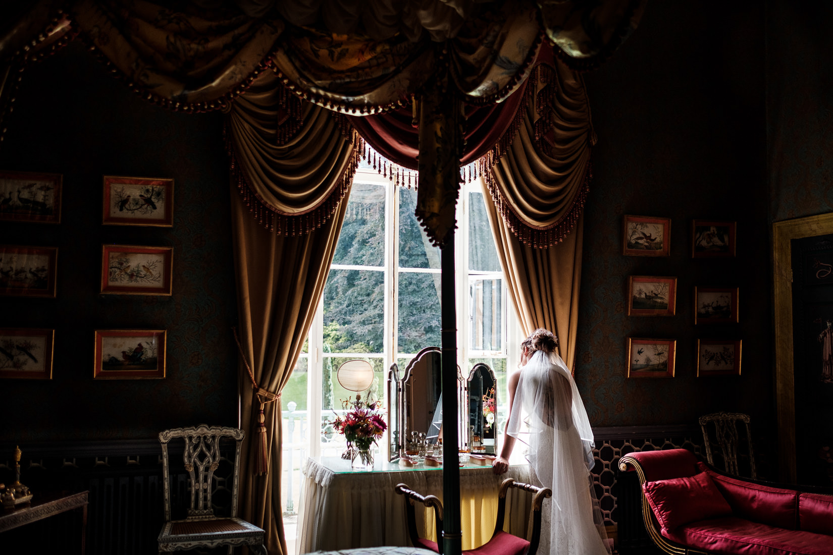 palatial bridal suite with bride staring out window